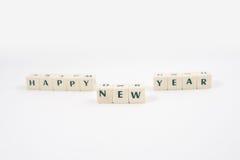 Texto blanco del cubo de la Feliz Año Nuevo Fotografía de archivo