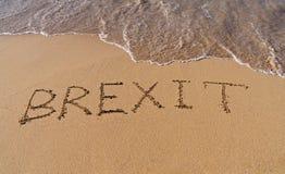 Texto Brexit de Handwrite no litoral da areia fotografia de stock