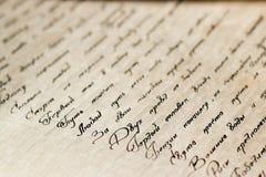 Texto caligráfico en el cuaderno viejo Imagen de archivo libre de regalías