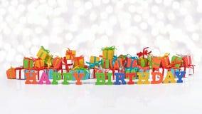Texto colorido del feliz cumpleaños en el fondo de regalos foto de archivo