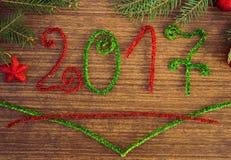 Texto 2017 com ramos do abeto Fotografia de Stock Royalty Free