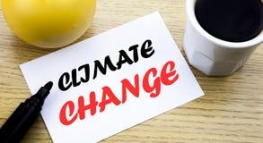 Texto conceptual da escrita da mão que mostra alterações climáticas Conceito do negócio para o planeta global que aquece a nota p Fotografia de Stock