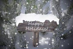 Texto da árvore de abeto dos flocos de neve do sinal do Natal boas festas Foto de Stock