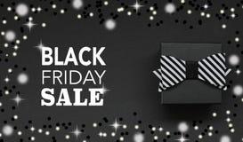 Texto da caixa de presente e do Black Friday com sparkles e luzes ilustração royalty free