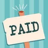 Texto da escrita da palavra pago O conceito do negócio para a dívida para o trabalho feitos recebe o pagamento durante a licença  ilustração stock