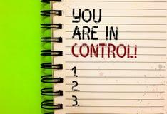 Texto da escrita da palavra você está no controle Conceito do negócio para a responsabilidade sobre um preto escrito autoridade d imagem de stock royalty free