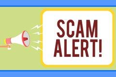 Texto da escrita que escreve o alerta de Scam Aviso do significado do conceito alguém sobre a observação do esquema ou da fraude  imagens de stock royalty free