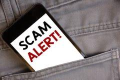 Texto da escrita que escreve a Scam a chamada inspirador alerta Aviso da segurança do significado do conceito para evitar a fraud fotos de stock