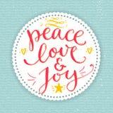 Texto da paz, do amor e da alegria Cartão de Natal com Fotografia de Stock