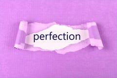 Texto da perfeição no papel rasgado fotografia de stock royalty free