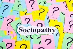 Texto da síndrome do Sociopathy em notas pegajosas coloridas na perspectiva dos pontos de interrogação Fotografia de Stock