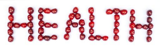 Texto da SAÚDE feito das cerejas Conceito Imagens de Stock Royalty Free