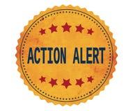 Texto de ACTION-ALERT, en sello de la etiqueta engomada del amarillo del vintage Imagenes de archivo