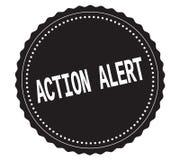 Texto de ACTION-ALERT, en sello negro de la etiqueta engomada Fotos de archivo