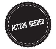 Texto de ACTION-NEEDED, en sello negro de la etiqueta engomada Imagenes de archivo