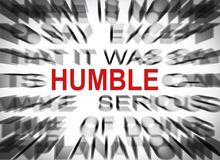 Texto de Blured con el foco en HUMILDE imagen de archivo libre de regalías