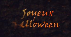 Texto de Joyeux Halloween en la disolución francesa en el polvo a la izquierda Foto de archivo libre de regalías