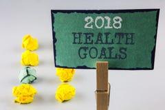Texto de la escritura que escribe la salud 2018 Golas Concepto que significa las metas sanas de la resolución de la comida del en Imagen de archivo