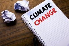 Texto de la escritura que muestra el cambio de clima Concepto del negocio para calentarse global del planeta escrito en el docume Imágenes de archivo libres de regalías