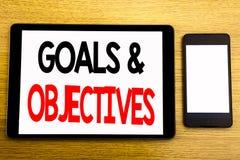 Texto de la escritura que muestra objetivos de las metas Concepto del negocio para el éxito Vision del plan escrito en el ordenad Foto de archivo