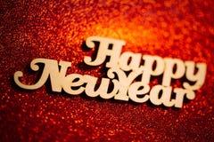 Texto de la Feliz Año Nuevo Decoraciones de la Navidad por Año Nuevo Fotografía de archivo libre de regalías