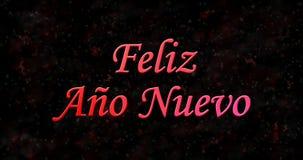 Texto de la Feliz Año Nuevo en español nuevo del ano de Feliz en backgr negro Fotografía de archivo