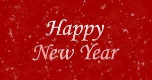 Texto de la Feliz Año Nuevo en fondo rojo Fotografía de archivo