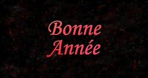 ¿Texto de la Feliz Año Nuevo en francés Bonne Ana? e en fondo negro Fotografía de archivo