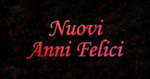 Texto de la Feliz Año Nuevo en italiano felici del anni de Nuovi en la parte posterior del negro Fotografía de archivo