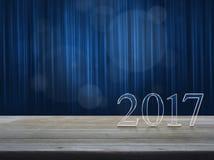 Texto de la Feliz Año Nuevo 2017 en la tabla de madera sobre la cortina azul con Imágenes de archivo libres de regalías