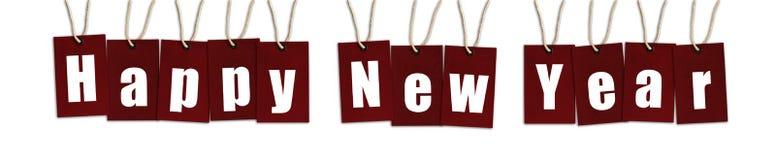 Texto de la Feliz Año Nuevo en las etiquetas del color rojo aisladas en Backgrou blanco imagen de archivo libre de regalías