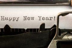 Texto de la Feliz Año Nuevo escrito por la máquina de escribir vieja Imagen de archivo libre de regalías