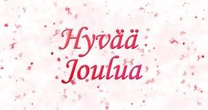 Texto de la Feliz Navidad en el joulua finlandés de Hyvaa formado del polvo y de las vueltas para sacar el polvo horizontalmente almacen de metraje de vídeo