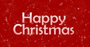 Texto de la feliz Navidad en fondo rojo Imagen de archivo