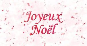 Texto de la Feliz Navidad en francés Joyeux Noel formado del polvo y de las vueltas para sacar el polvo horizontalmente almacen de metraje de vídeo