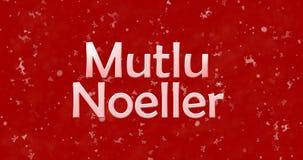 Texto de la Feliz Navidad en turco Mutlu Noeller en backgroun rojo Imagen de archivo