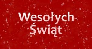 Texto de la Feliz Navidad en Wesolych polaco Swiat en backgroun rojo Imagen de archivo