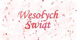 Texto de la Feliz Navidad en Wesolych polaco Swiat en el backgro blanco Imagen de archivo libre de regalías