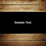 Texto de la muestra en el fondo de madera del tablón Fotos de archivo