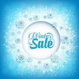 Texto de la venta del invierno en el espacio blanco del círculo con las escamas de la nieve Imágenes de archivo libres de regalías