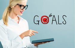 Texto de las metas con la mujer de negocios fotos de archivo
