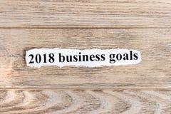texto de 2018 objetivos de negócios no papel Objetivos de negócios da palavra 2018 no papel rasgado Imagem do conceito Imagens de Stock Royalty Free