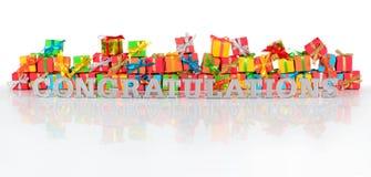 Texto de plata de la enhorabuena y regalos varicolored imagen de archivo libre de regalías