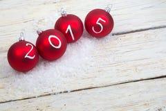 Texto del Año Nuevo 2015 en las chucherías de la Navidad Imagen de archivo libre de regalías