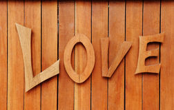 Texto del amor en fondo de madera Imagenes de archivo