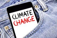 Texto del aviso de la escritura que muestra el cambio de clima Concepto del negocio para el planeta global que calienta el teléfo Foto de archivo libre de regalías