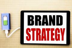 Texto del aviso de la escritura que muestra estrategia de la marca Concepto del negocio para el plan de comercialización de la id Fotos de archivo