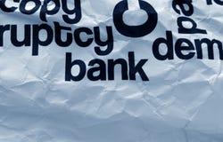 Texto del banco en el papel arrugado Foto de archivo libre de regalías