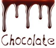 Texto del chocolate del flujo del jarabe de chocolate Imagenes de archivo