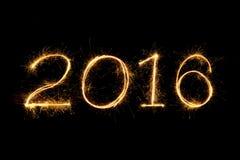 Texto del fuego artificial de 2016 chispas Foto de archivo libre de regalías